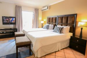 A bed or beds in a room at WeStay Apartments-Timessquare