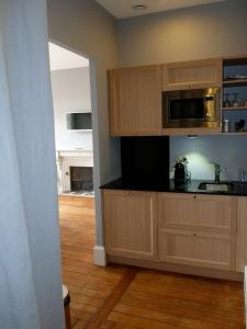 A kitchen or kitchenette at Villa Beaupeyrat Appart-hotel