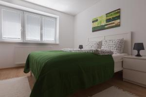 A bed or beds in a room at Zoerentals Zlatovska