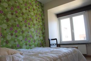Un ou plusieurs lits dans un hébergement de l'établissement Golden Tulip