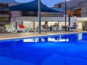 The swimming pool at or near Mont Clare Boutique Apartments