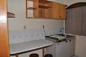 A kitchen or kitchenette at Apart Hotel Universitário