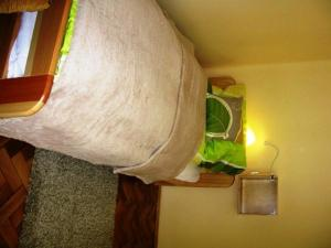 Postel nebo postele na pokoji v ubytování Zrínyi Apartman