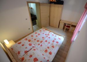 A bed or beds in a room at Apartments Mojca