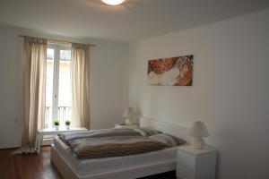 Ein Bett oder Betten in einem Zimmer der Unterkunft Apartment Mirabell