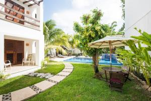 The swimming pool at or near Villas El Encanto Cozumel