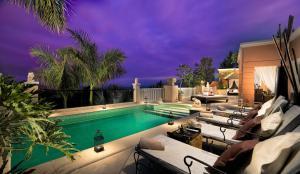 The swimming pool at or near Royal Garden Villas & Spa GL