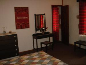 A bed or beds in a room at Halases Apartments