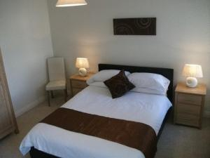 A bed or beds in a room at Falcon's Nest Self Catering Apartments