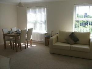 A seating area at Falcon's Nest Self Catering Apartments