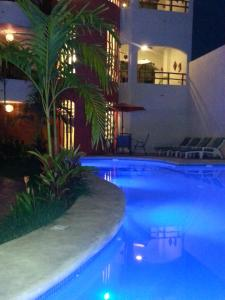 The swimming pool at or near Hotel y Suites Los Encantos