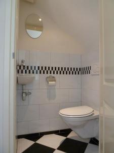 Ein Badezimmer in der Unterkunft Appartement De Vuurtoren