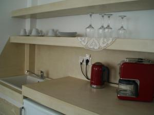 A kitchen or kitchenette at Scorpios Hotel & Suites