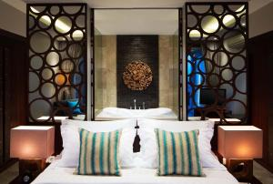 A bed or beds in a room at Sun Island Suites & Spa Goa Gong
