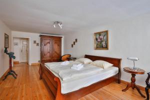 Ein Bett oder Betten in einem Zimmer der Unterkunft Apartments Friederike