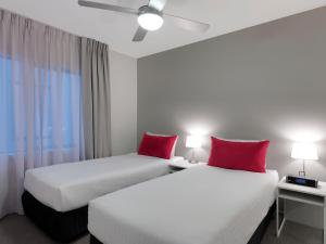 A bed or beds in a room at Adina Apartment Hotel St Kilda Melbourne