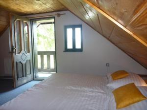 A bed or beds in a room at Penzion Olšina 31