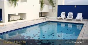 The swimming pool at or near Residence Plaza Flat