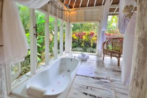 A bathroom at Jendela Di Bali Villa