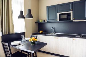 מטבח או מטבחון ב-Heritage Home Apartments