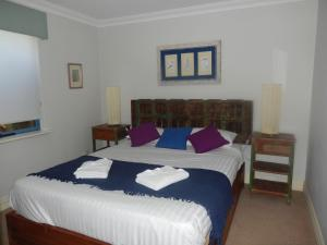 A bed or beds in a room at Manuel Towers Corporate Units