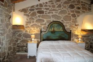 A bed or beds in a room at Stazzo Gallurese La Cugara