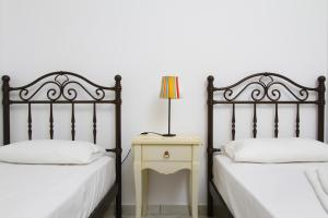 A bed or beds in a room at Saint Thomas Village