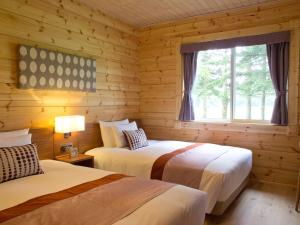A bed or beds in a room at The Prince Villa Karuizawa