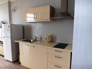 A kitchen or kitchenette at Orbi Plaza Apartment
