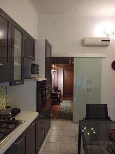 A kitchen or kitchenette at Montecassino24