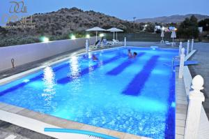 The swimming pool at or near Daniel Luxury Apartments