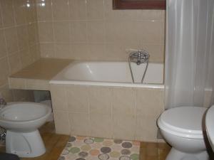A bathroom at Apartments Cabrajac
