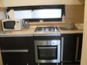 O bucătărie sau chicinetă la Apartamente Club Bosco