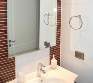 Un baño de MG Apartments Providencia