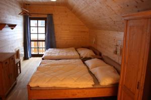 Postel nebo postele na pokoji v ubytování Vinařova chalupa