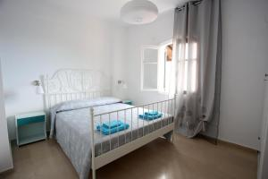 A bed or beds in a room at Casa Kalami