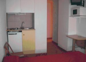 A kitchen or kitchenette at Aparthotel Condor