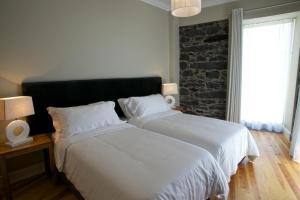Cama o camas de una habitación en The Docks Apartments