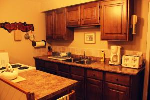 A kitchen or kitchenette at Port Renfrew Country Cottage