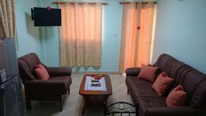 Zona de estar de Villa Bedier Self-catering Apartments