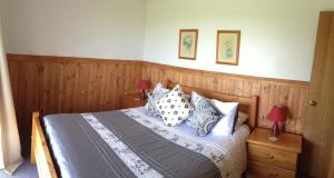 A bed or beds in a room at Buln Buln Cabins