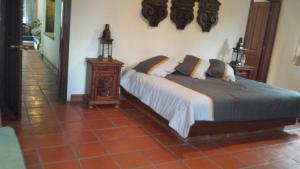 A bed or beds in a room at Villas Balvanera FH