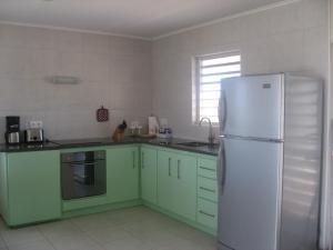 A kitchen or kitchenette at Haus Im Wind