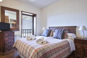 Cama o camas de una habitación en Baqueira Apartamentos Cota 1700