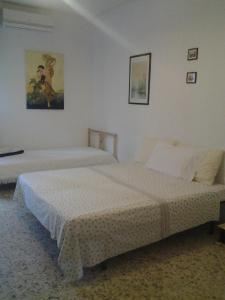 A bed or beds in a room at Apartment City Center Taormina