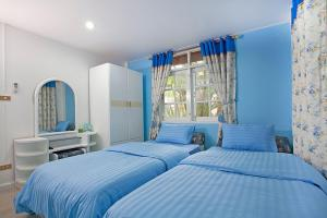 A bed or beds in a room at Jomtien Paradise Villa