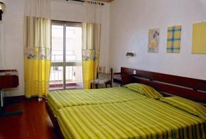 Uma cama ou camas num quarto em Hotel Apartamento Iate