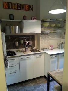 A kitchen or kitchenette at Apartment Amelie Suite