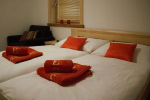 A bed or beds in a room at Apartmány Skihouse Jasná