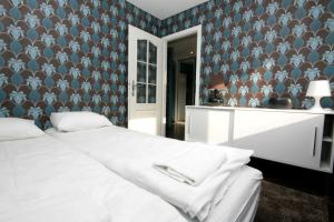 A bed or beds in a room at Rent a Flat apartments - Mazurska St.